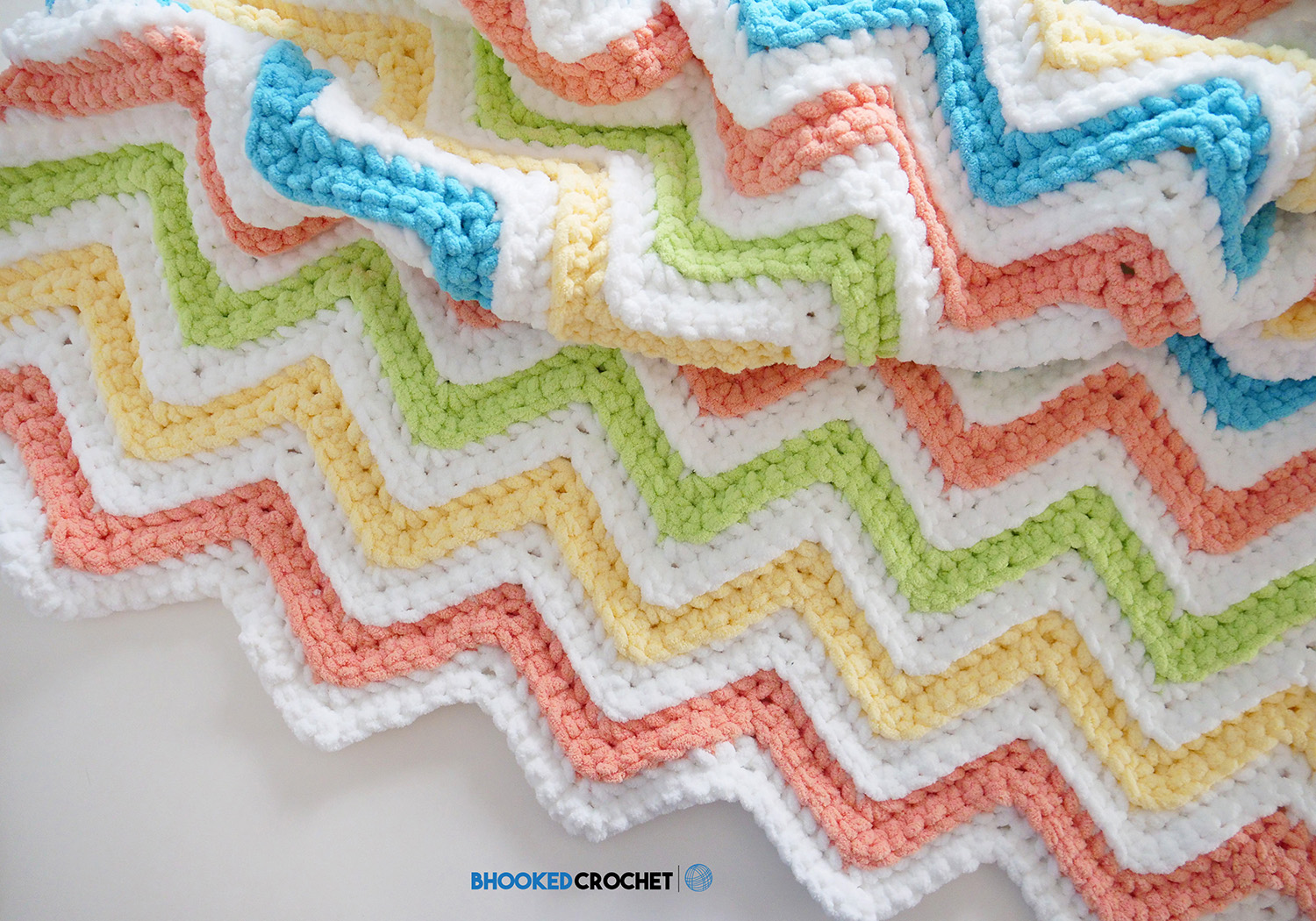 Learn How to Make the Simple Chevron Baby Blanket by Yarnspirations